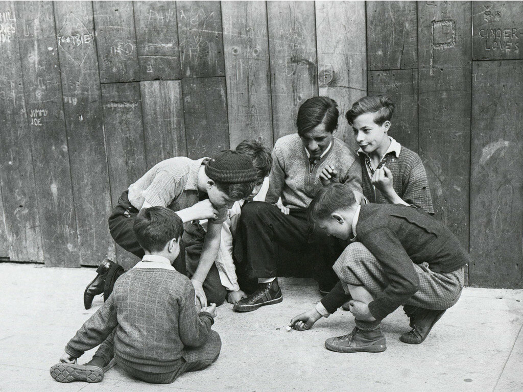 Juvenile delinquents gambling on the street in NYC