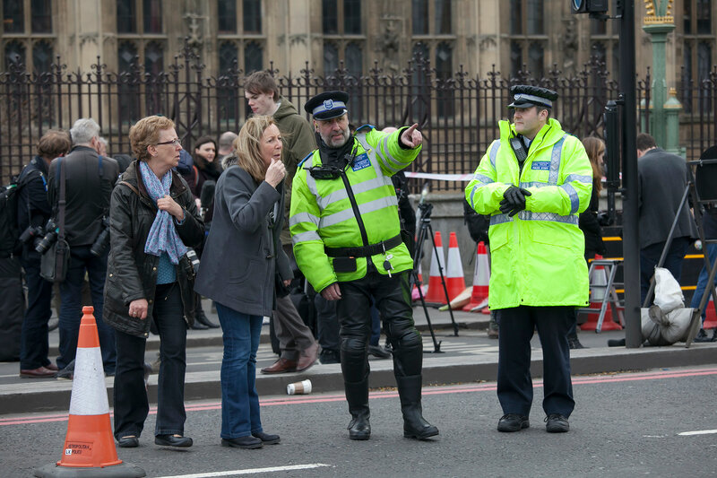 Police officers stand guard on a road leading to the Houses of Parliament in London. After the terrorist attack