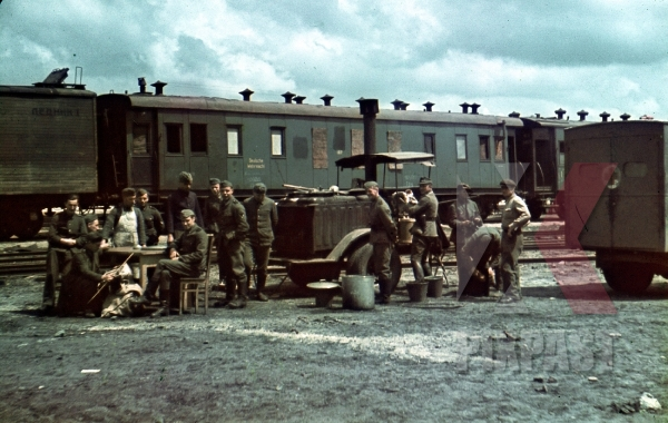 stock-photo-ww2-color-german-army-field-kitchen-in-train-station-train-wagons-transport-ukraine-1943-7949.jpg