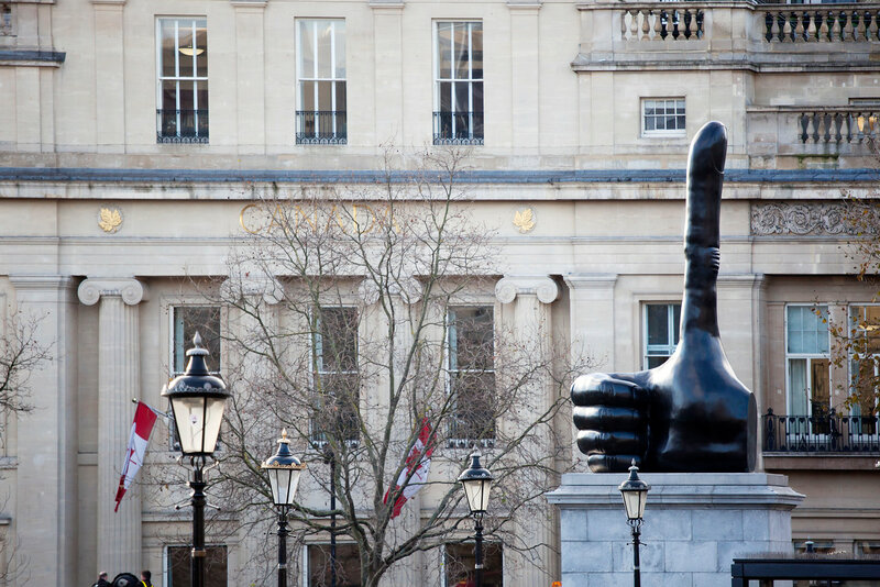 Trafalger square with sculpture thumbs up