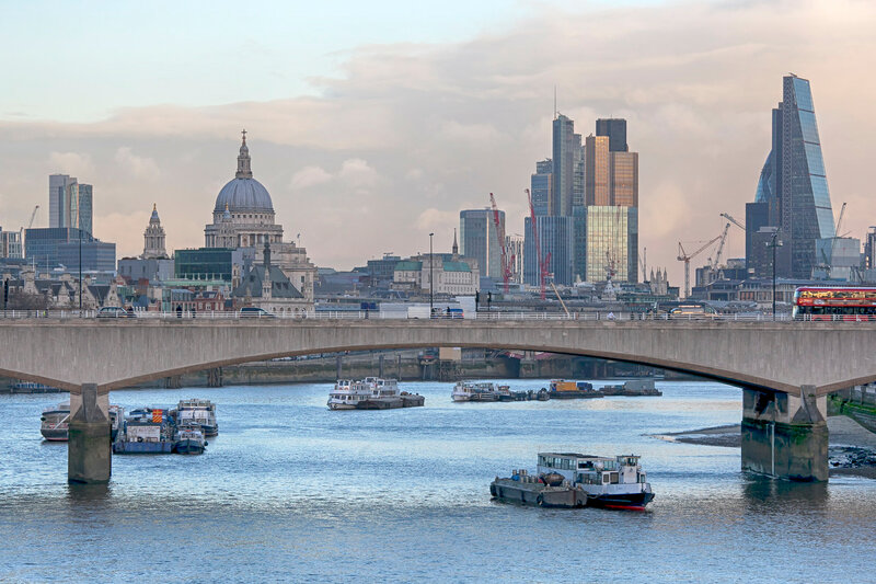 LONDON, UNITED KINGDOM - JANUARY 15: Cannon Railway bridge over river Thames with cruising ship and Cannon street station, on January 15, 2016 in London, England