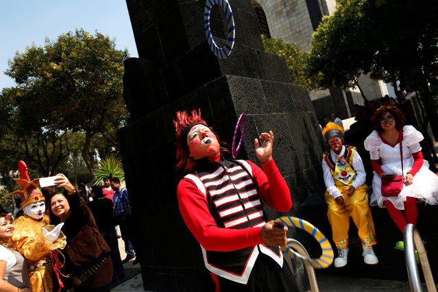 A clown juggles on the street during XXI Convention of Clowns, at the Jimenez Rueda Theatre, in Mexi