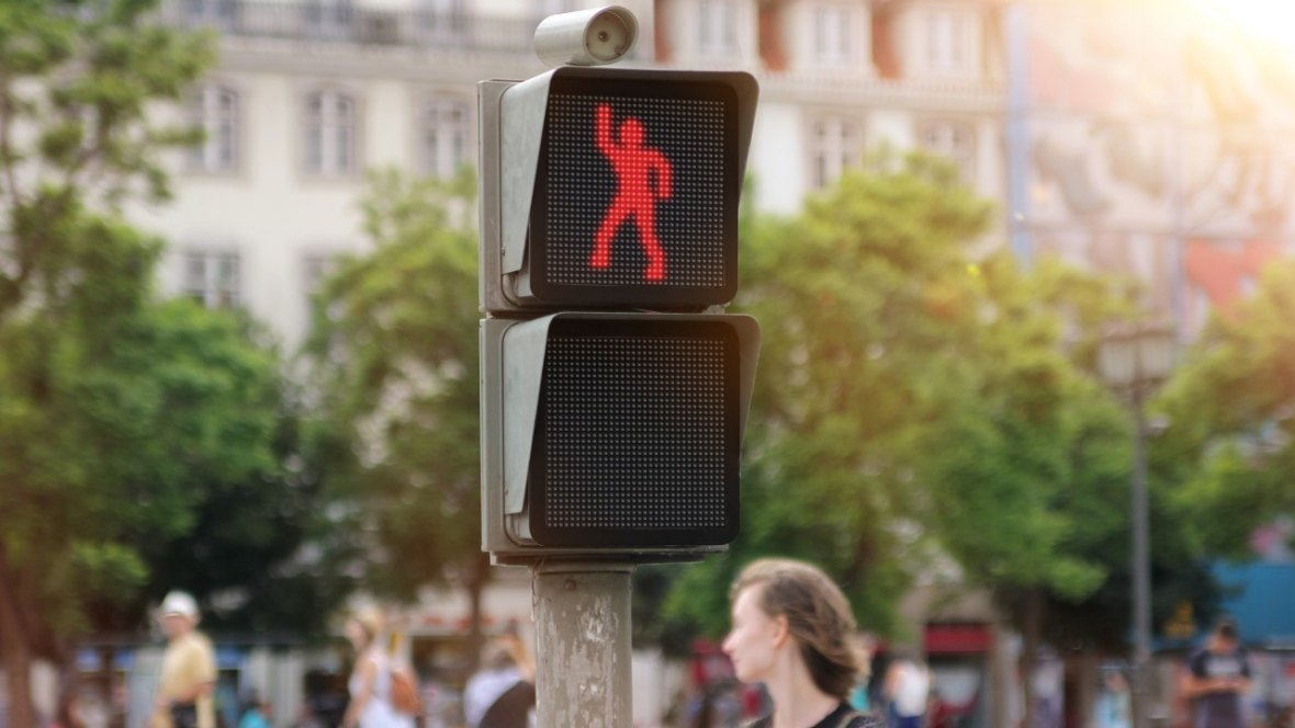 An Interactive Dancing Pedestrian Signal by Smart