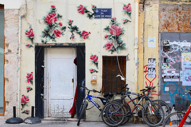 The foral cross-stitch street art by Raquel Rodrigo is beautiful and poetic (18 pics)