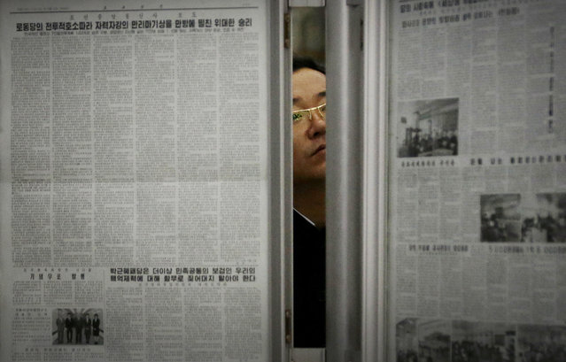 In this May 7, 2016, file photo, a North Korean man reads the local newspapers displayed in a subway