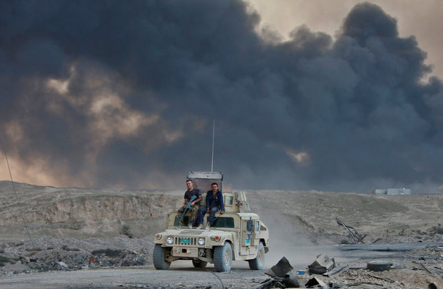 An Iraqi army vehicle is seen during an operation to attack Islamic State militants in Mosul, in Qay