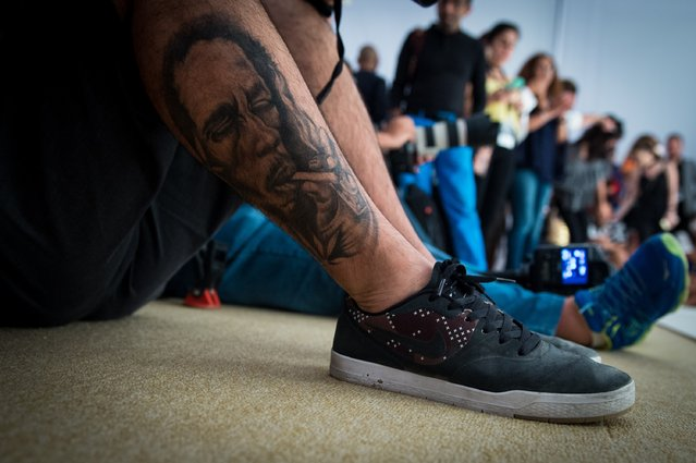 Tattoo of a guest as he attends the Bedouin Presentation at Fashion Forward Spring/Summer 2017 held