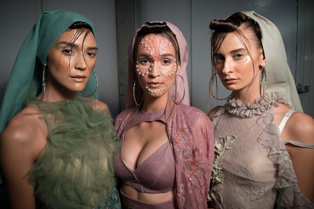Models backstage ahead of the Amato show during Fashion Forward Spring/Summer 2017 at the Dubai Desi