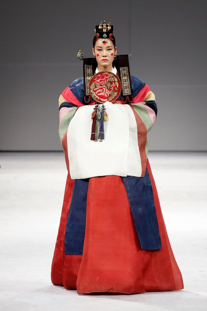 "A Model walks down the catwalk during the South Korean Traditional Costume ""HanBok"" fashion show at"