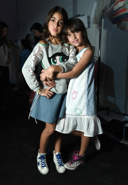 Models backstage ahead of the Powerpuff Girls & S*ucette presentation during Fashion Forward Spring/