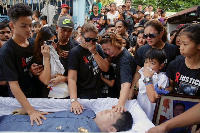 Mother and other close relatives of Rancel Cruz, a police officer killed by an unknown gunman earlie