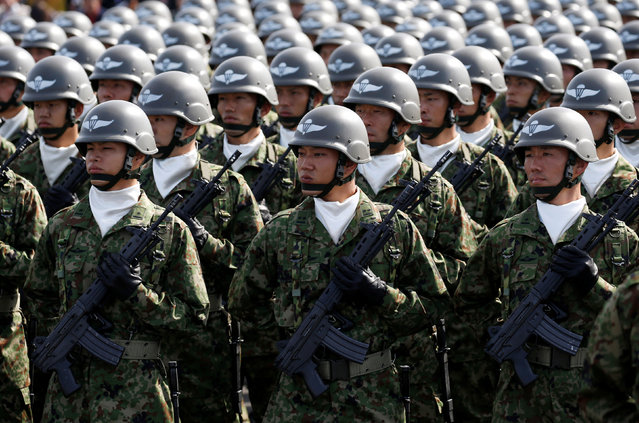 Members of Japan's Self-Defence Forces' airborne troops stand at attention during the annu