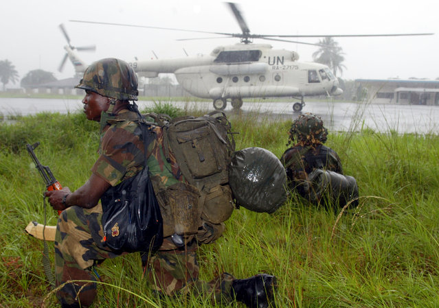 The first contingent of Nigerian troops arrives at the Monrovia international airport in Liberia, Au