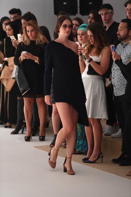 A model poses at the Hashe presentation during Fashion Forward Spring/Summer 2017 at the Dubai Desig