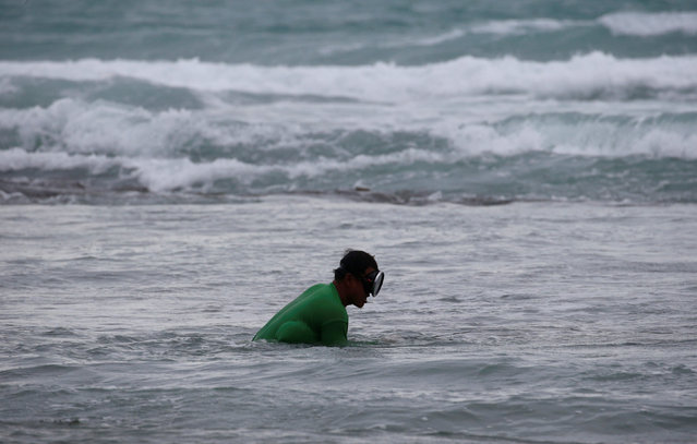 A man fishes amidst bad weather as Typhoon Haima struck Pagudpud, Ilocos Norte, in northern Philippi
