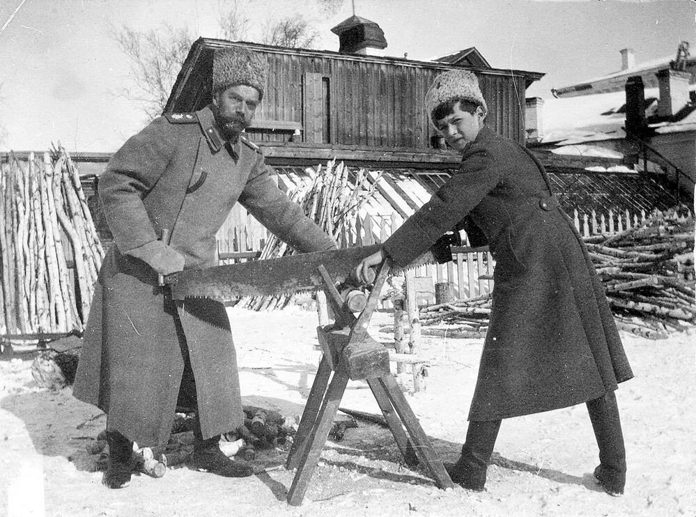 1918 Emperor Nicholas II sawing wood with Alexei during the Imperial Family's winter at Tobolsk.jpg