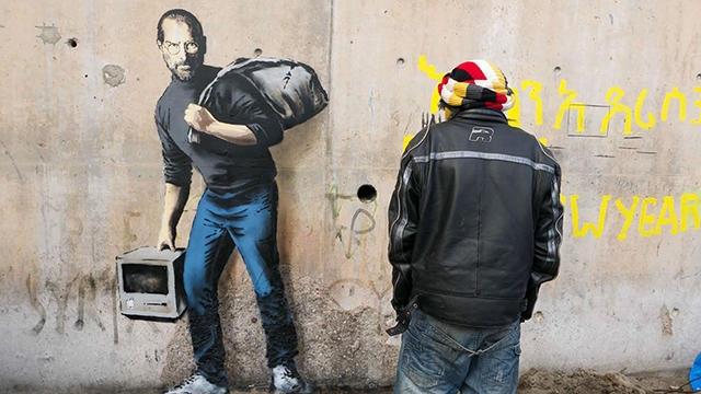 Бэнкси нарисовал потомка сирийских мигрантов Стива Джобса на стене в лагере беженцев (5 фото)
