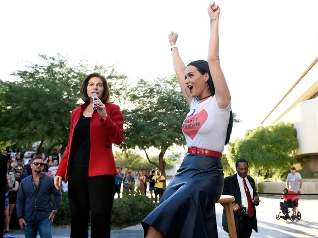Singer Katy Perry (R) cheers as former Nevada Attorney General and democratic U.S. Senate candidate