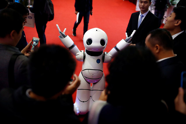 People look at a humanoid Urobot by Xiao Yanlin at the WRC 2016 World Robot Conference in Beijing, C