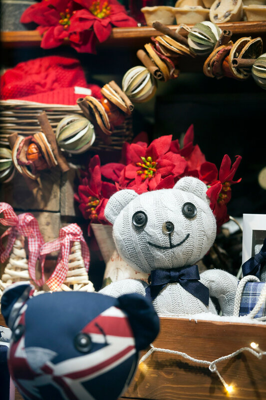 London, UK - December 19, 2016: teddy bear, deer, and Christmas decorations on the Southwark open market in London. Christmas background