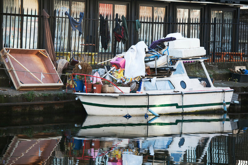 Boat loaded with various junk, standing at Regent canal