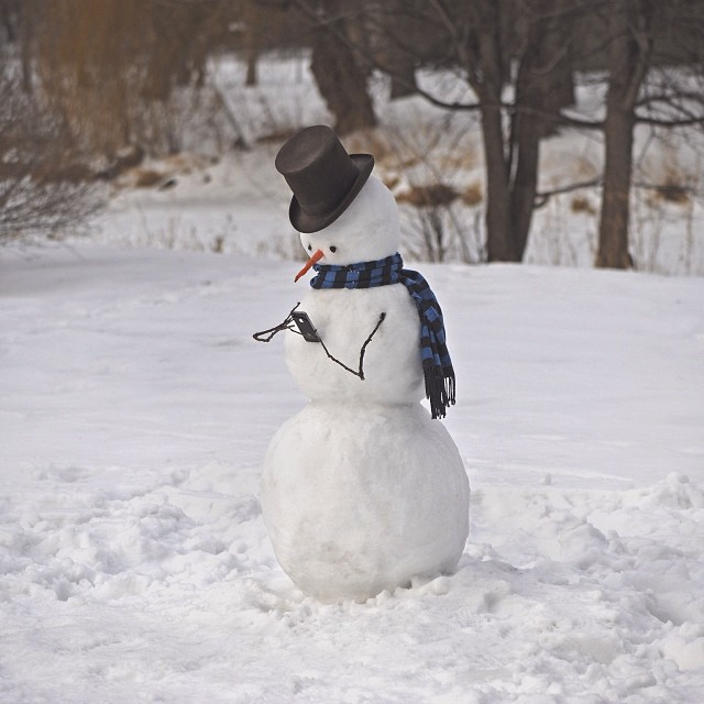 Snowman on his smartphone