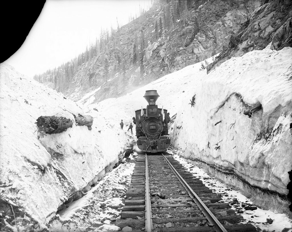 D&RG narrow gauge locomotive 203 at Snowslide Tunnel, above Elk Park Colorado on the Silverton Branch, 1909
