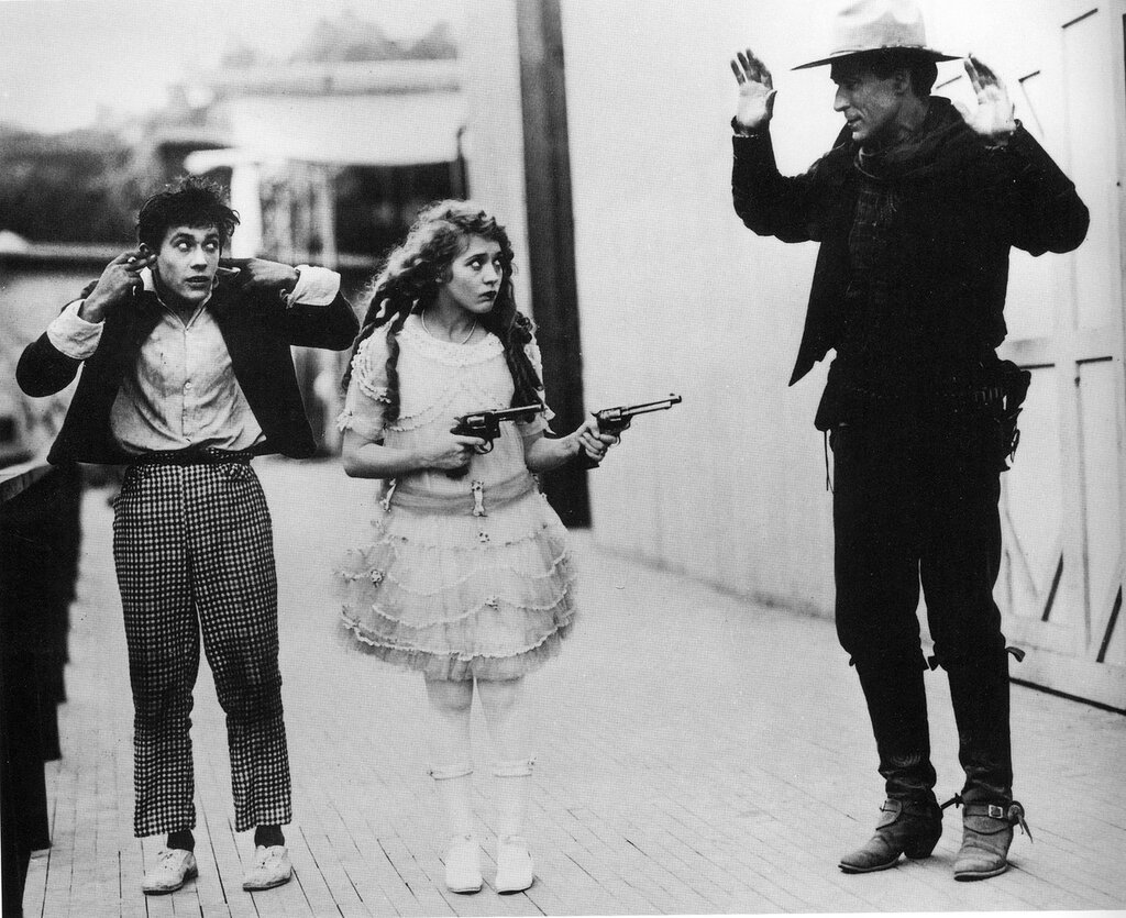 Mary and brother Jack Pickford stage a hold-up of cowboy actor Tom More