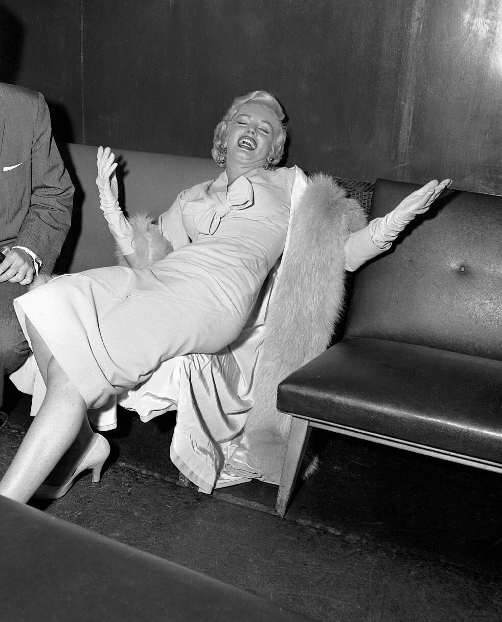 Marilyn Monroe Laughing on Couch