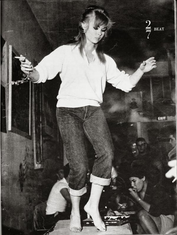 Beatnik girl dancing on a table, 1960s.jpg