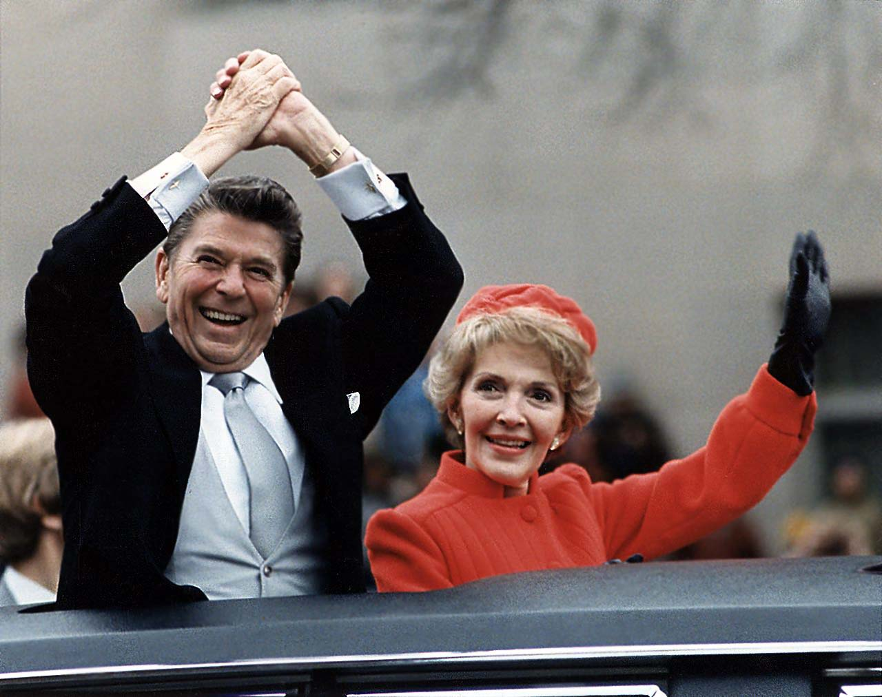 The Reagans waving from the limousine during_the Inaugural Parade on January 20 1981