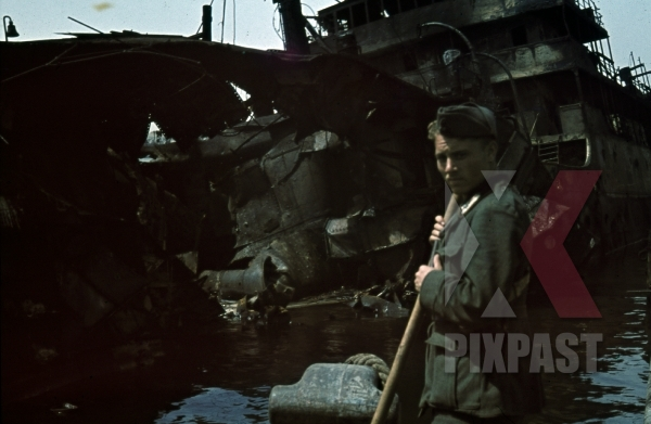 stock-photo-tripoli-harbour-in-libya-1942-destroyed-burning-german-transport-ships-after-allied-air-attack-italian-soldier-cleaning-11242.jpg