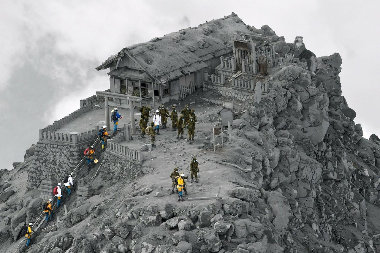 Rescuers at a shrine near the summit of Mt. Ontake, the volcano which erupted last week, killing at least 51 with 13 still buried under rocks and ash..jpg