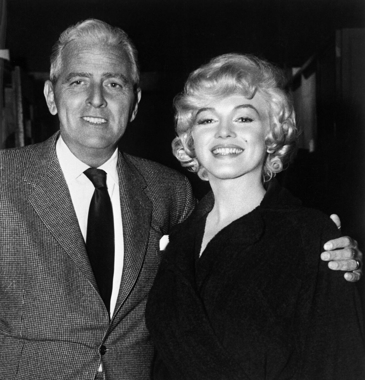 Marilyn with Buddy Adler