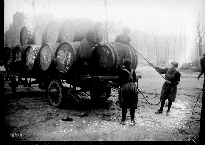 Women unloading barrels Bordeaux France