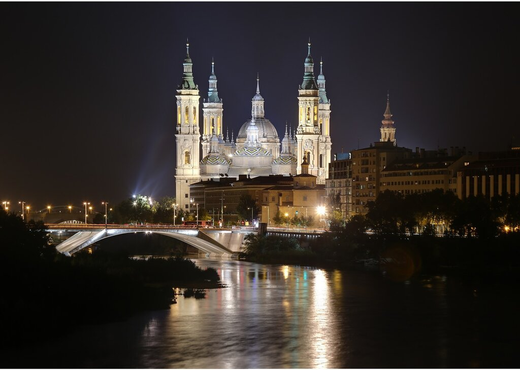 Zaragoza. The Cathedral of the virgin Pilar at night. View from the bridge of Almosara.
