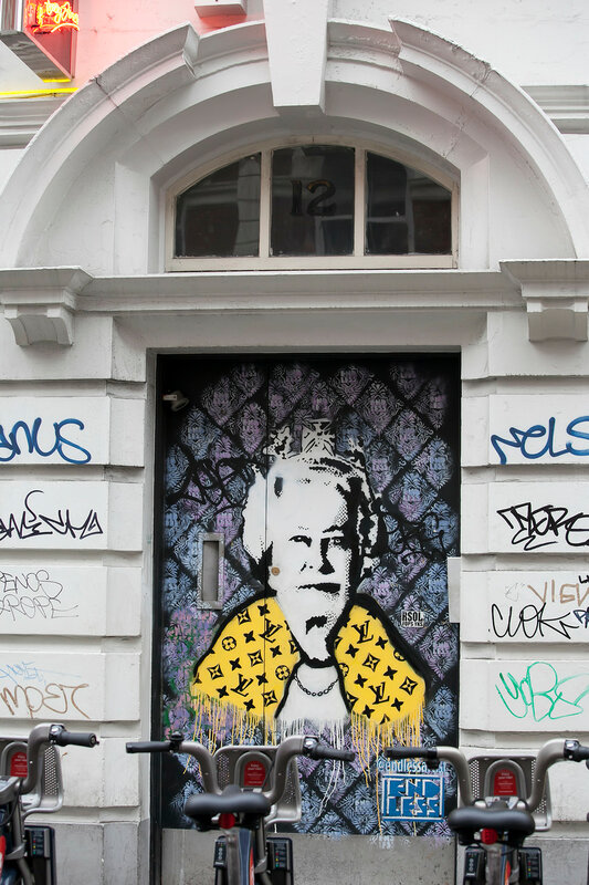 November 2016 - London, United Kingdom: A graffiti of the Royal Queen in yellow dress in Soho