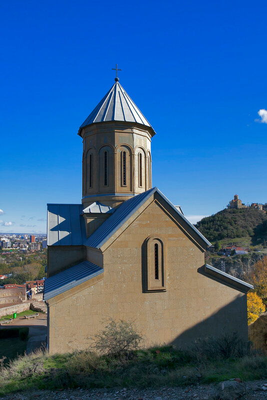 Narikala Fortress with the St Nikolas church and the architecture in the surrounding Old Town of Tbilisi, Republic of Georgia, Caucasus, in the early morning, at sunrise.