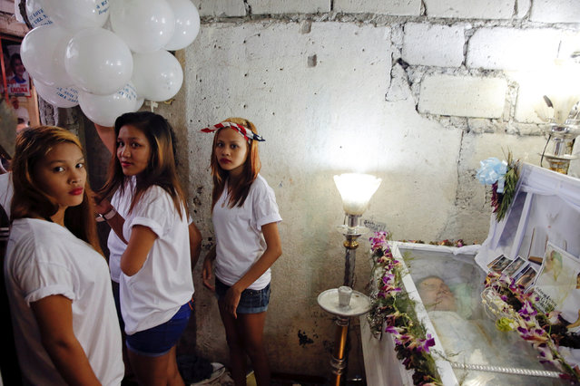 Relatives hold balloons next to a coffin with the body of Benjamin C. Visda Jr, who was killed durin
