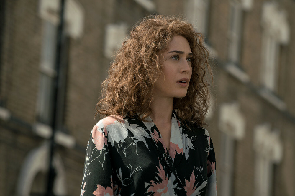 Lizzy Caplan plays Bridget Vatan in Allied from Paramount Pictures.