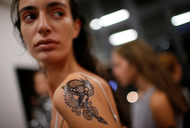 A model shows her temporary tattoo backstage at the Tbilisi Fashion Week in Tbilisi, Georgia, Octobe