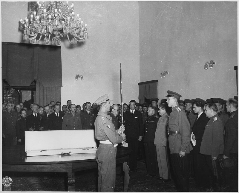 The_Prime_Minister_in_behalf_of_King_George_VI_of_Great_Britain,_presents_The_Sword_of_Stalingrad_to_Stalin,_for_the..._-_NARA_-_195332.jpg