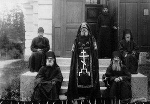 Схимник среди монахов и послушников монастыря.