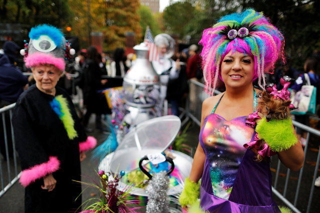 Revellers take part in the annual halloween dog parade at Manhattan's Tompkins Square Park in N