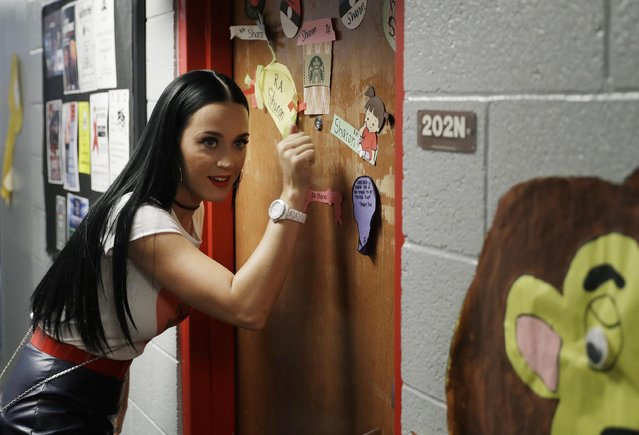 Singer Katy Perry canvasses for Democratic presidential nominee Hillary Clinton in a dorm at the Uni