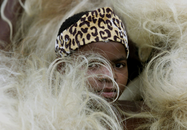 A boy dressed as a traditional Zulu warrior attends the launching ceremony of the African Union (AU)