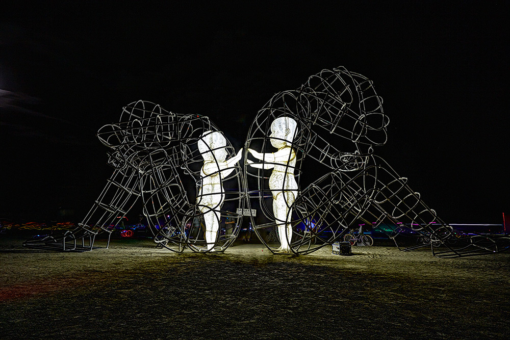 Large Wire-Frame Sculpture Shows the Glowing Forms of Children Trapped Within Adult Bodies (6 pics)