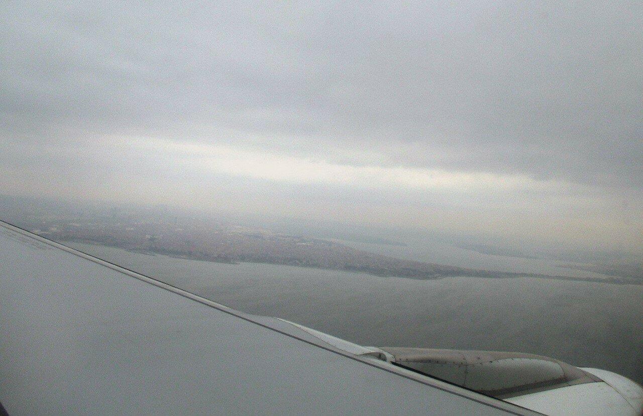 Boarding at Ataturk airport. Over the Marmara sea. Bay Kucukcekmece