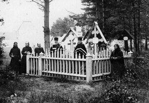 Группа схимников и монахов на монастырском кладбище.