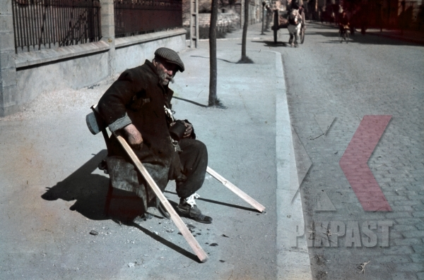 stock-photo-french-homeless-person-begging-on-street-only-one-leg-with-wooden-crutches-horse-wagon-paris-france-1940-11797.jpg